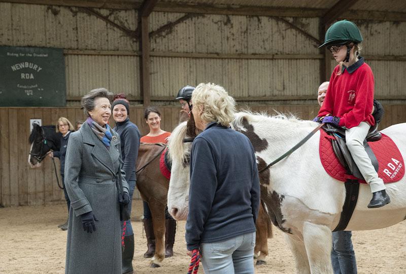 HRH talking to rider, Olivia Taylor
